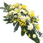 Yellow and white double ended spray by Funeral Flowers London